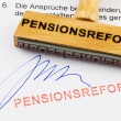 Foto Stock: Wooden stamp on document: pension reform