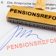 Wooden stamp on document: pension reform — Stockfoto #8841470