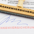 Stock Photo: Wooden stamp on document: health insurance