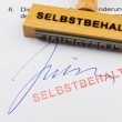 Wooden stamp on the document: deductible — Stock Photo