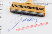 Wooden stamp on the document: uncollectible — Stock Photo