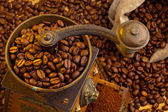 Coffee beans with coffee grinder — Stock Photo