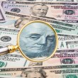 Dollar currency notes photographed with a magnifying glass - Stock Photo