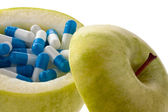 Apple with tablets capsules. icon vitamintab — Stock Photo