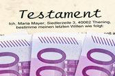 Euro banknotes and testament — Stock Photo