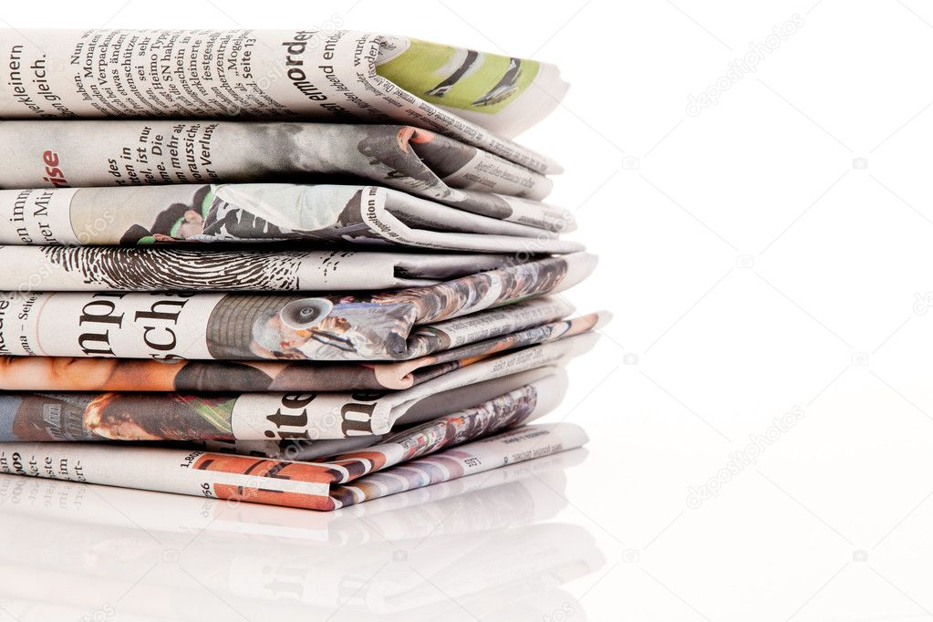 Old newspapers and magazines in a pile — Stock Photo #9998428