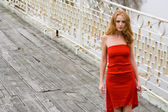 Girl in red dress — Stock Photo