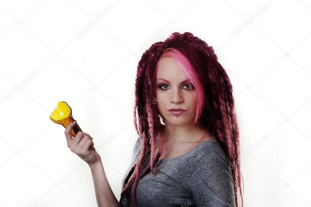 Woman with dread lock hair holding a broken beer bottle what is she going to do with it — Stock Photo #9854040