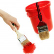 Woman's hand with  brush and  red bucket. — Stock Photo