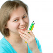 Stock Photo: Young smiling womholding two pens.