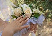 Bouquet of flowers in his hands the bride. — Stock Photo