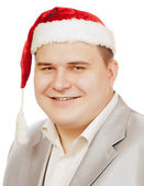Young man in hat Santa Claus. — Stock Photo