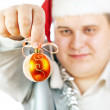 Young man holding a Christmas toy. — Stock Photo