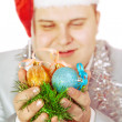 Stock Photo: Young man holds Christmas toys.