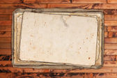 Weathered empty papers on a wooden background — Stock Photo