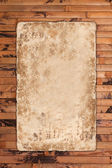 Vintage empty paper on a wooden background — Stock Photo