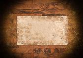 Ahşap üzerine eski bir soluk kağıt — Stok fotoğraf
