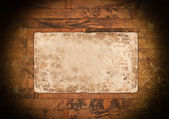 Old faded paper on wood — Stock Photo