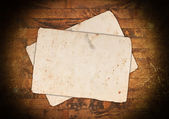 Old empty papers on a wooden background — Stock Photo