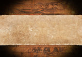 Damged paper roll on dark wooden background — Stock Photo