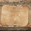 Aged papers on a wooden background - Photo