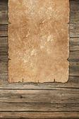 Ciemny wyblakłe rolką na tle drewniane — Zdjęcie stockowe