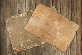 Faded old papers on a wooden background — Stock Photo
