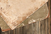 Vintage old papers on a wooden background — Stock Photo
