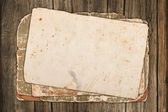 Faded old papers on a wooden background — Stock fotografie