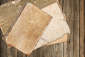 Old book and papers on a wooden background — Photo