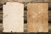 Old papers on a wooden background — Stock Photo