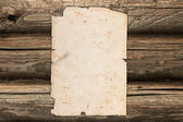 Crumpled old paper on a wooden background — Stock Photo