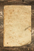 Vintage old paper sheet on a wooden background — Stock Photo