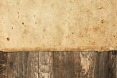 Old ragged paper on a wooden background — Stock Photo