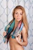 Lovely young brunette fashion model with a scarf — Stock Photo