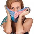 Seductive brunette holding a scarf to her face - Stock Photo
