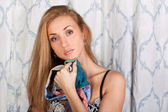 Elegant brunette fashion model with a scarf — Stockfoto
