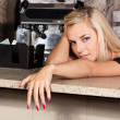 Young beautiful blond model at a bar table - Zdjęcie stockowe