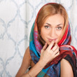 Stylish young woman in a colorful scarf — Stock Photo