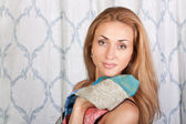 Young elegant brunette woman with a colorful scarf — Stock Photo