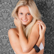 Lovely blond girl in white bikini smiling — Stock Photo #8415706