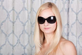 Pretty youngblond girl in stylish sun glasses — Stock Photo