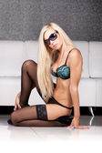 Gorgeous young blond woman in seductive black lingerie — Stock Photo