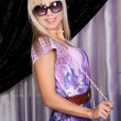 Stock Photo: Joyful blond girl in stylish sun glases