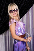 Joyful blond girl in stylish sun glases — Stock Photo