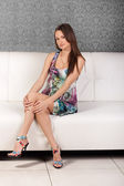 Portrait of a young gorgeous brunette in a sexy dress — Stock Photo