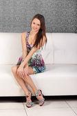 Smiling young brunette girl in an elegant dress — Stockfoto