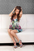 Cute young brunette girl in an elegant dress — Stock Photo