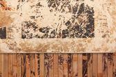 Weathered paper on a wooden background — Stock Photo