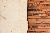 Aged paper on a wooden background — Stock Photo